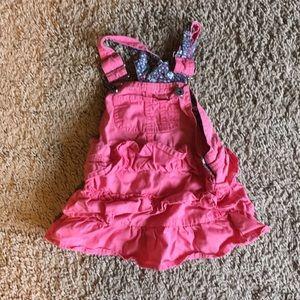 Adorable pink baby girl ruffle skirtall overalls